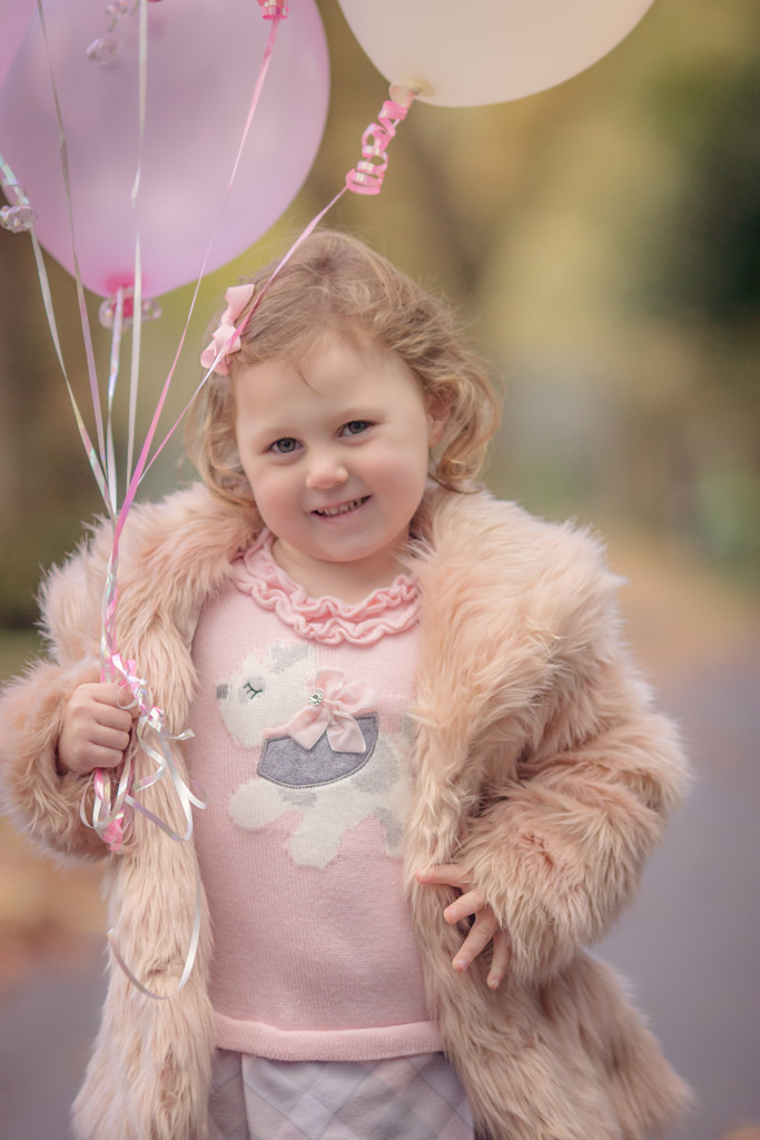 Little Girl Posing with Balloons