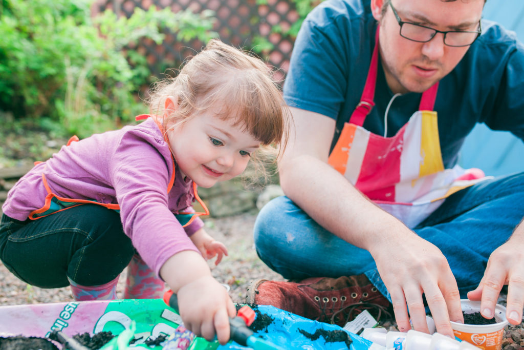 Girl and Daddy Gardening
